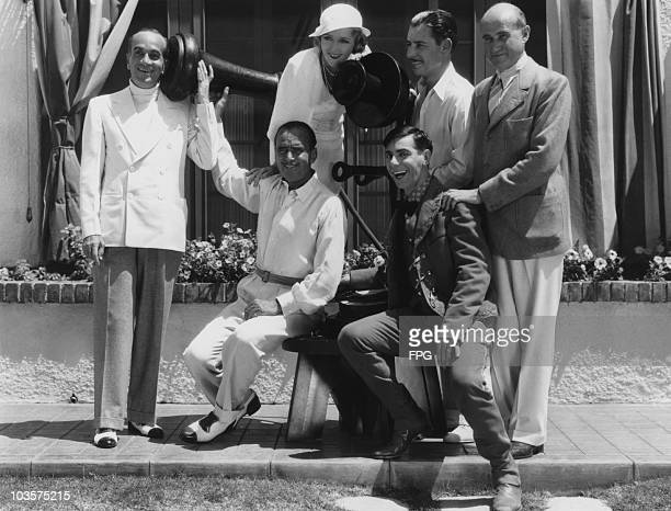 Actress Mary Pickford pictured with actors Al Jolson Douglas Fairbanks Eddie Cantor Ronald Colman and film producer Samuel Goldwyn grouped around an...