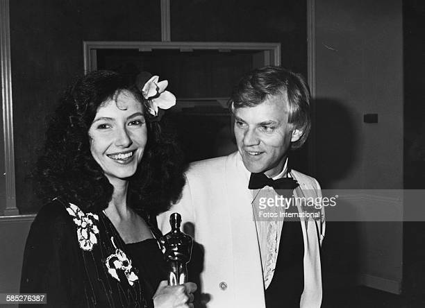 Actress Mary Steenburgen holding her Best Supporting Actress Oscar for the film 'Melvin and Howard', with her husband Malcolm McDowell, at the 53rd...