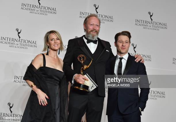 Actress Mary Stuart Masterson and actor Ben McKenzie pose with Danish actor Lars Mikkelsen who won the award for Best Performance by an Actor during...