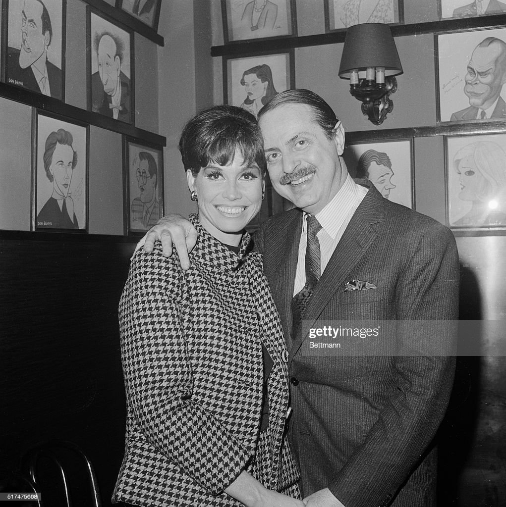 Actress Mary Tyler Moore and producer David Merrick still manage to smile after the producer announced here December 14th that the play, Breakfast at Tiffany's had folded in advance. The musical was scheduled to open on Broadway Dec. 26th. Merrick said he was closing the show 'rather than subject theater-goers to an excrutiatingly boring evening.' The play, which was to have starred Miss Moore and Richard Chamberlain, had several difficulties during seven weeks in Boston and Philadelphia.