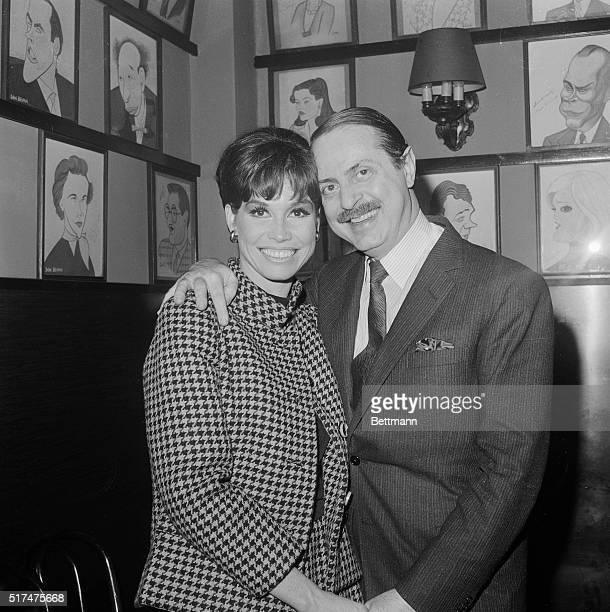 Actress Mary Tyler Moore and producer David Merrick still manage to smile after the producer announced here December 14th that the play Breakfast at...