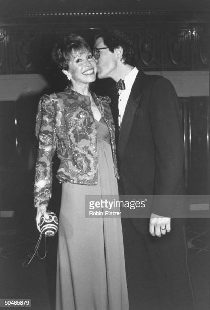Actress Mary Tyler Moore being kissed by her husband Robert Levine during 20th anniversary of her TV series Mary Tyler Moore Show