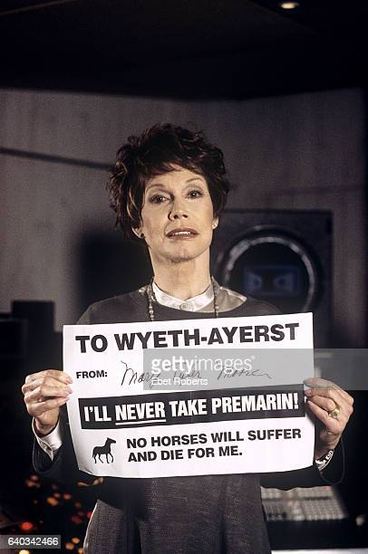 Actress Mary Tyler Moore holding a PETA protest sign in New York City on April 1 1996