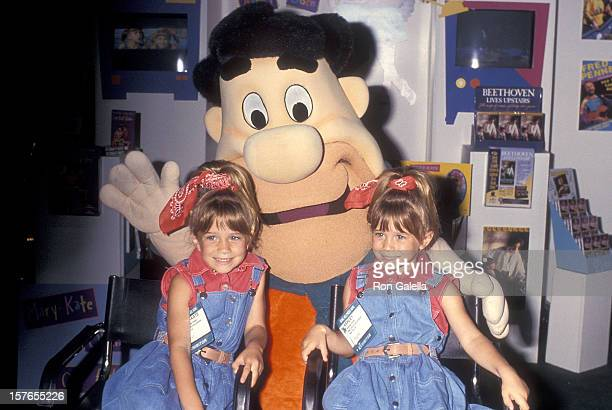 Actress MaryKate and Ashley Olsen and Fred Flintstone attend the 12th Annual Video Software Dealers Association Convention and Expo on July 11 1993...