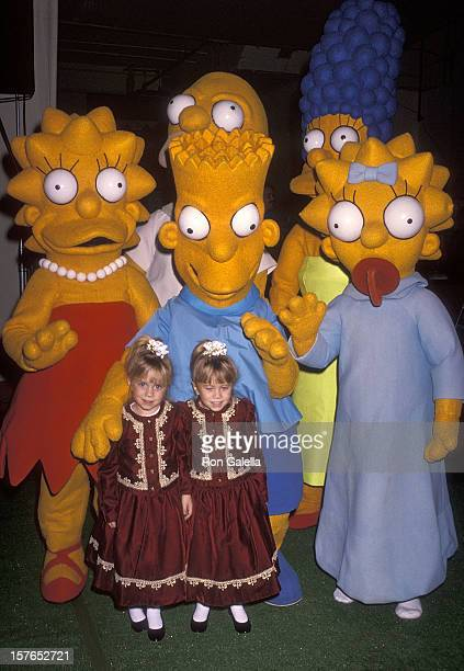 Actress Mary-Kate and Ashley Olsen and The Simpsons attend the 60th Annual Hollywood Christmas Parade on December 1, 1991 at KTLA Studios in...