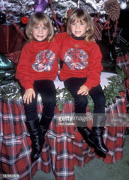Actress MaryKate and Ashley Olsen attend the 61st Annual Hollywood Christmas Parade on November 29 1992 at KTLA Studios in Hollywood California