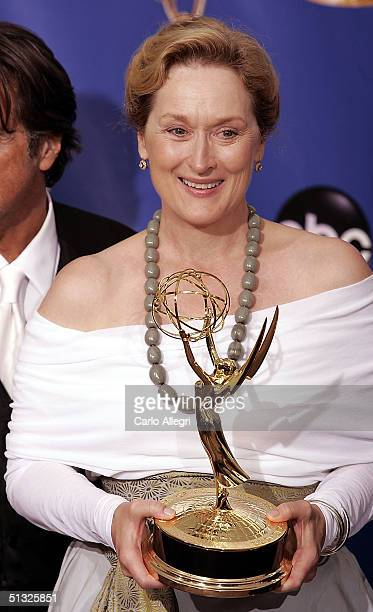 Actress Maryl Streep poses with her award for Best Actreess in a Miniseries of Movie for Angels in America backstage during the 56th Annual Primetime...