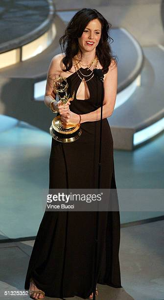 Actress MaryLouise Parker accepts her award for Best Supporting Actress in a Miniseries or Movie for Angels in America on stage during the 56th...