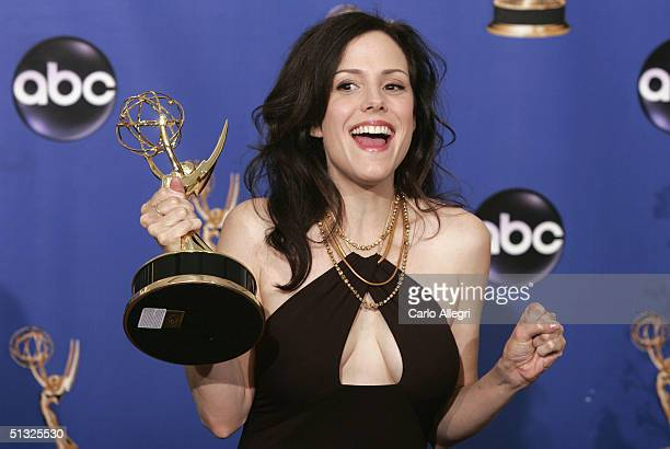 Actress MaryLouise Parker winner for Outstanding Supporting Actress in a Miniseries or Movie for Angels in America poses with her Emmy backstage...