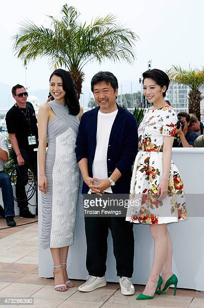 Actress Masami Nagasawa director Hirokazu Koreeda and actress Kaho attend a photocall for 'Umimachi Diary' during the 68th annual Cannes Film...