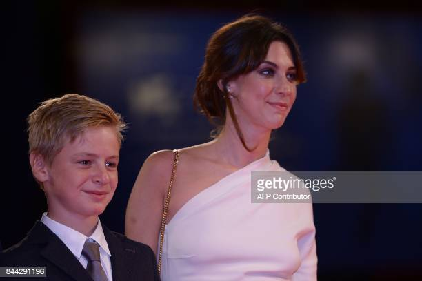 Actress Mathilde Auneveux and actor Thomas Gioria attend the premiere of the movie 'Jusqu'à la Garde' presented in competition at the 74th Venice...