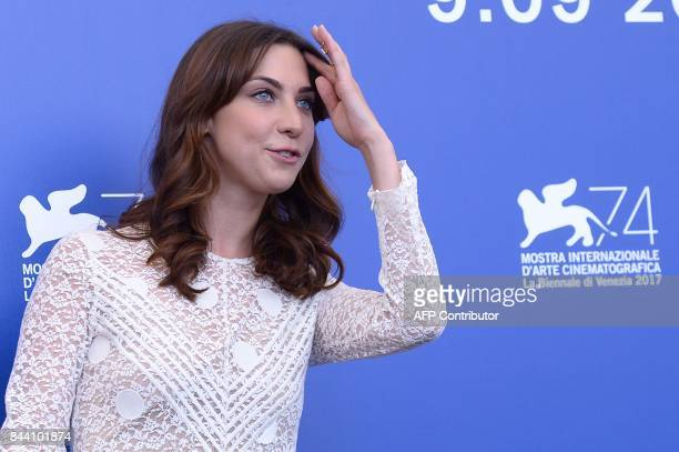 Actress Mathilde Auneveux attends the photocall of the movie 'Jusqu'à la Garde' presented in competition at the 74th Venice Film Festival on...