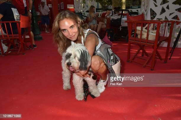 Actress Mathilde Laffont and her thibetan dog Talung attend the Trophee Senequier 2018 at Place des Lices SaintTropez On French Riviera on August 17...