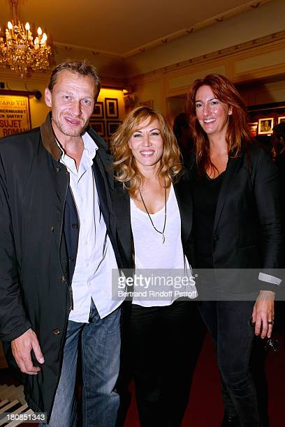Actress Mathilde Seigner standing between Nicolas Altmayer and his wife attend 'Nina' Premiere at Theatre Edouard VII on September 16 2013 in Paris...