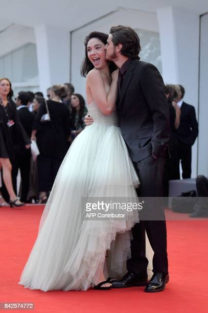 Actress Matilda de Angelis and Italian actor Andrea Arcangeli kiss on the red carpet before the premiere of the movie 'Una Famiglia' presented in...