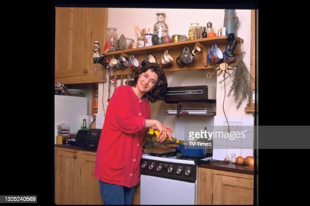 Actress Maureen Beattie photographed cooking at home, circa 1997.
