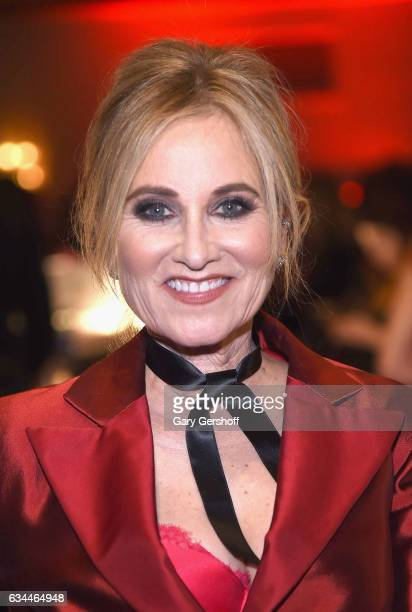 Actress Maureen McCormick poses backstage at the American Heart Association's Go Red for Women Red Dress Collection during February 2017 New York...