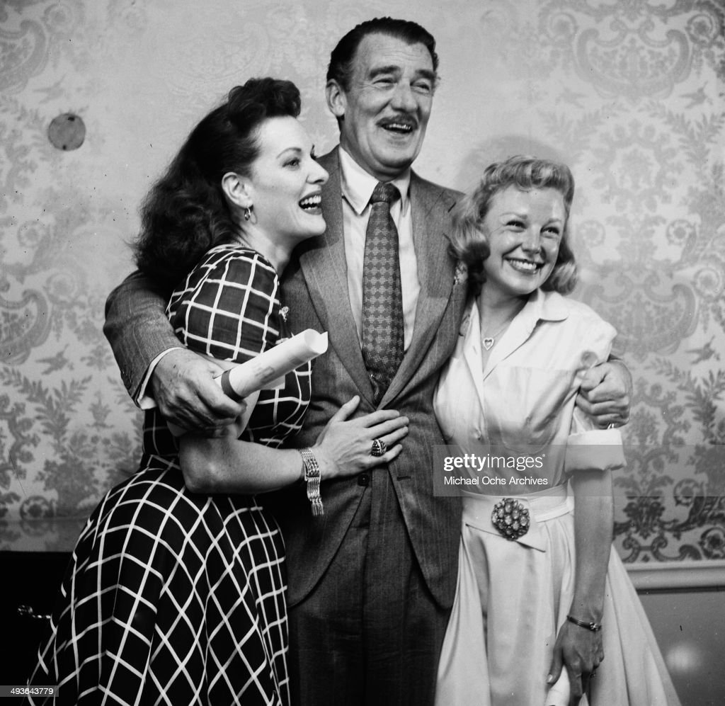 Actress Maureen O'Hara, actor Walter Pidgeon and actress June Allyson pose at a party in Los Angeles, California.