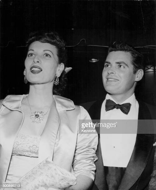 Actress Maureen O'Hara and her brother Charles B Fitzsimons in formal dress attending an event circa 1950