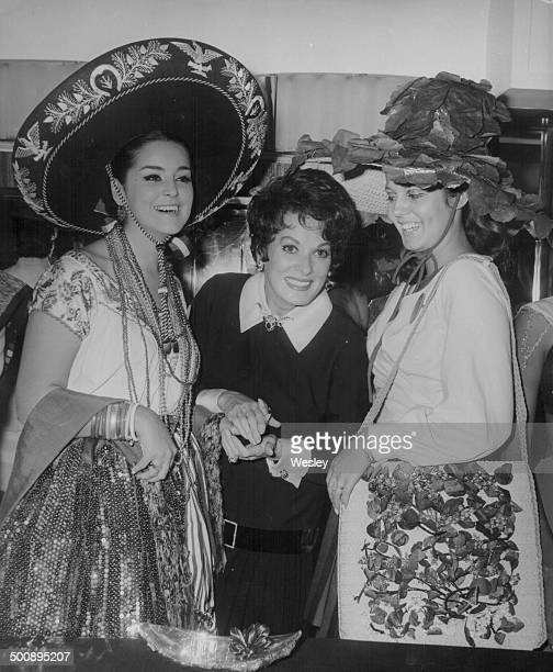 Actress Maureen O'Hara with 'Miss Mexico' and 'Miss Brazil' attending the Variety Club Luncheon Savoy Hotel London November 13th 1967