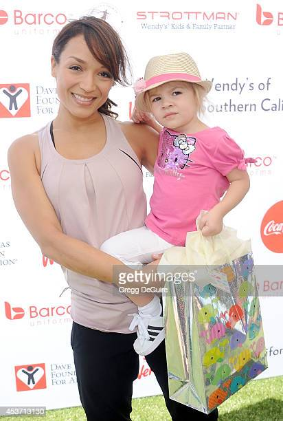 Actress Mayte Garcia and daughter Gia arrive at The Dave Thomas Foundation for adoption's kickball for a home celebrity kickball game at University...