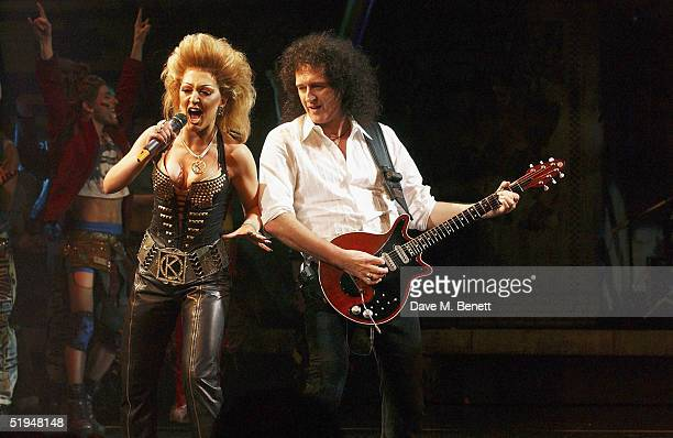 """Actress Mazz Murray joins musician Brian May with the on-stage band for the 1000th performance of Ben Elton's musical """"We Will Rock You"""" at the..."""