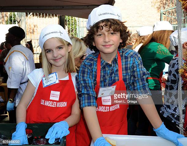 Actress McKenna Grace and actor August Maturo at the Los Angeles Mission Thanksgiving Meal For The Homeless held at Los Angeles Mission on November...