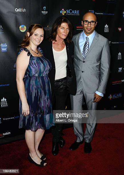 Actress Meg Foster and agent Chris Roe arrive for sCare Foundation's 2nd Annual Halloween Benefit held at The Conga Room at LA Live on October 28...