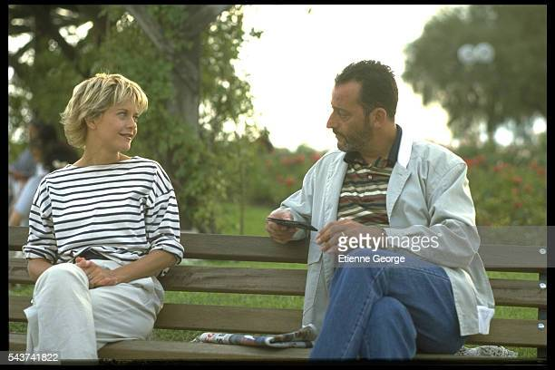 Actress Meg Ryan and French actor Jean Reno on the set of the film French Kiss directed by Lawrence Kasdan