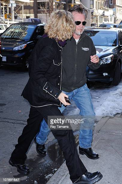 Actress Meg Ryan and singer John Mellencamp enter EAT restaurant on January 5 2011 in New York City