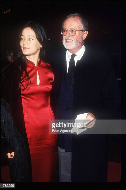 Actress Meg Tilly and an unidentified man attend the premiere of the film 'Jerry Maguire' at Pier 88 December 6 1996 in New York City The film tells...