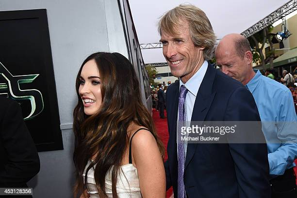 Actress Megan Fox and producer Michael Bay attend the premiere of Paramount Pictures' Teenage Mutant Ninja Turtles at Regency Village Theatre on...