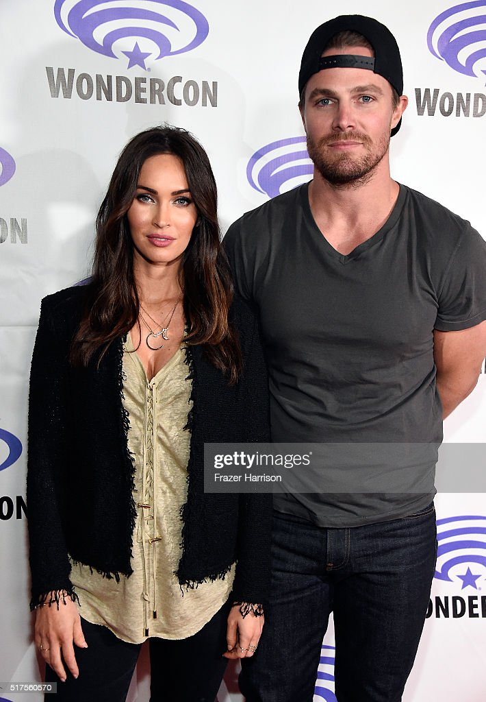 "Actress Megan Fox (L) and Stephen Amell attend a panel at WonderCon 2016 to promote the upcoming release of Paramount Pictures' ""Teenage Mutant Ninja Turtles – Out of The Shadows"", on March 25, 2016 at the LA Convention Center in Los Angeles, California."