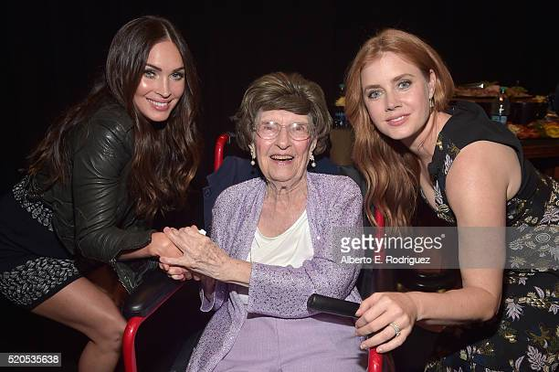 Actress Megan Fox, longest working theatre employee and current box office cashier, Evylyna Shubarth and actress Amy Adams attend the CinemaCon 2016...