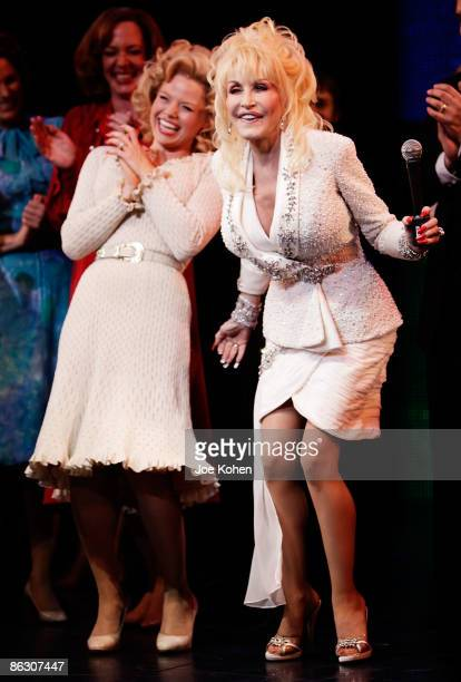 Actress Megan Hilty and singer Dolly Parton on stage during curtain call at the opening of 9 to 5 The Musical on Broadway at the Marriott Marquis...
