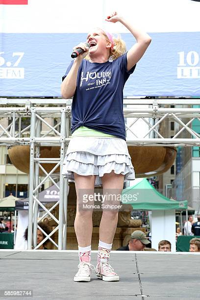 Actress Megan Lawrence of 'Holiday Inn' performs on stage at 1067 LITE FM's Broadway In Bryant Park 2016 at Bryant Park on August 4 2016 in New York...