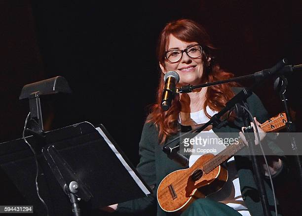 Actress Megan Mullally performs Summer Of 69 No Apostrophe with husband Nick Offerman at Beacon Theatre on August 23 2016 in New York City