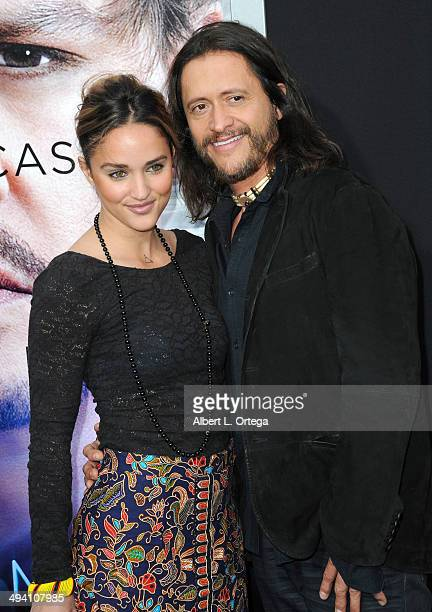 Actress Megan Ozurovich and actor Clifton Collins Jr arrive for the Premiere Of Warner Bros Pictures And Alcon Entertainment's Transcendence held at...