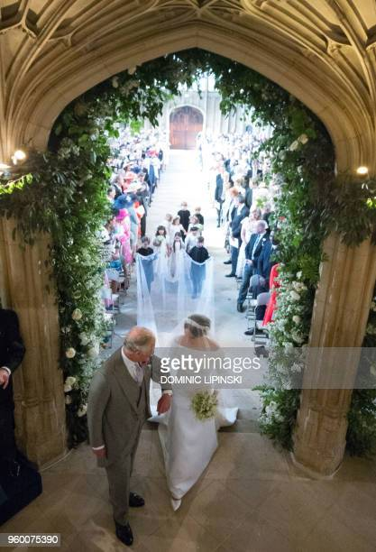 Actress Meghan Markle , accompanied by Britain's Prince Charles, Prince of Wales walks down the aisle in St George's Chapel, Windsor Castle, in...