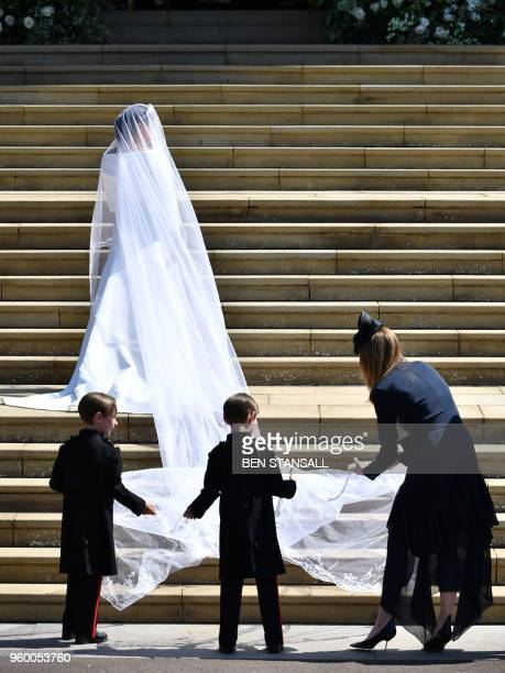 TOPSHOT US actress Meghan Markle arrives for the wedding ceremony to marry Britain's Prince Harry Duke of Sussex at St George's Chapel Windsor Castle...