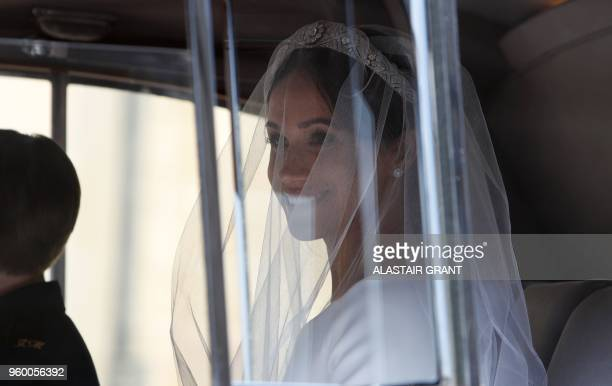 US actress Meghan Markle arrives for the wedding ceremony to marry Britain's Prince Harry Duke of Sussex at St George's Chapel Windsor Castle in...