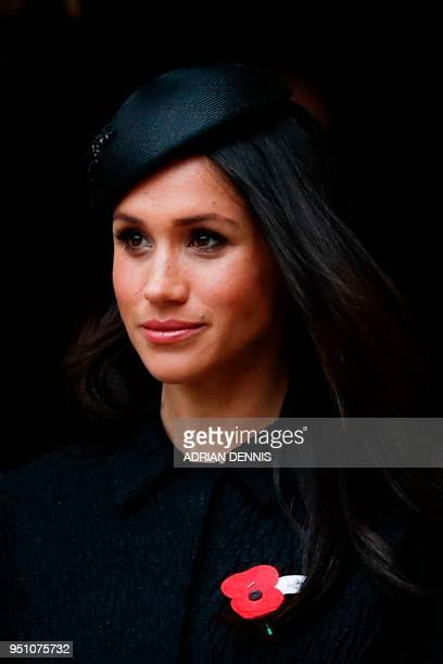 Actress Meghan Markle, Britain's Prince Harry's fiancee, leaves after attending a service of commemoration and thanksgiving to mark Anzac Day in...