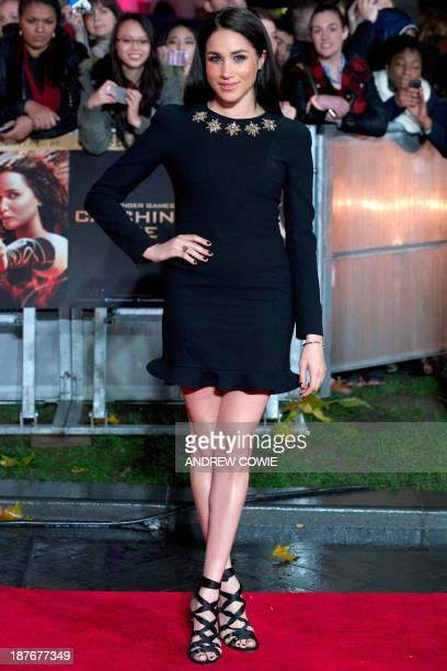 US actress Meghan Markle poses for pictures on the red carpet upon arrival for the world premier of the film The Hunger Games Catching Fire in...