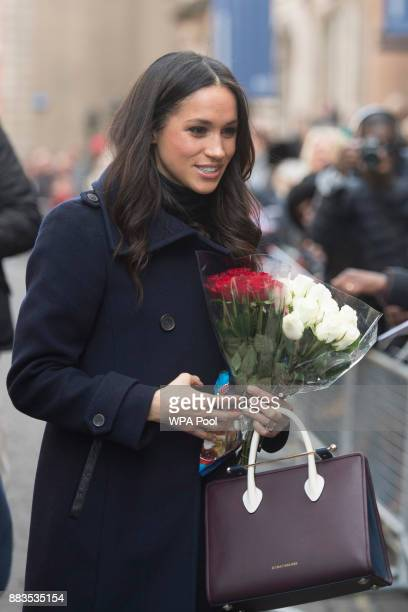 US actress Meghan Markle visits Nottingham for her first official public engagement with fiancee Prince Harry on December 1 2017 in Nottingham...