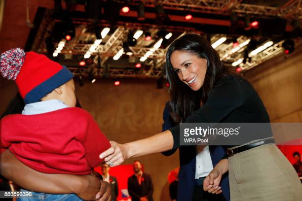 US actress Meghan Markle visits the Terrence Higgins Trust World AIDS Day charity fair at Nottingham Contemporary with fiancee Prince Harry on...