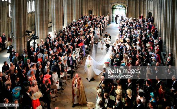 Actress Meghan Markle walks down the aisle in St George's Chapel, Windsor Castle, in Windsor, on May 19, 2018 during her wedding to Britain's Prince...