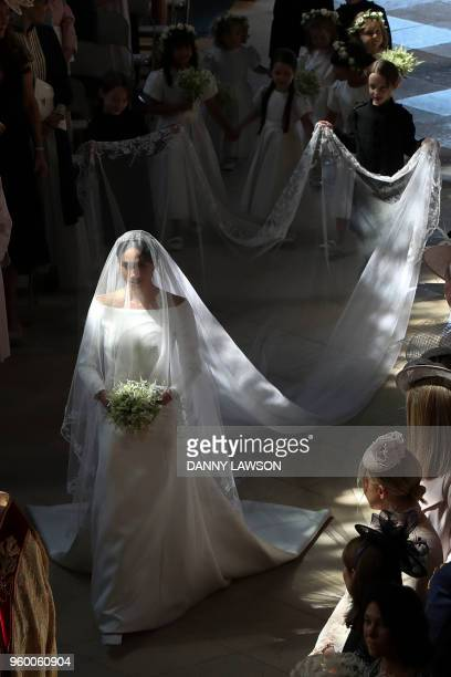 US actress Meghan Markle walks down the aisle in St George's Chapel Windsor Castle in Windsor on May 19 2018 during her wedding to Britain's Prince...