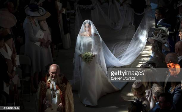 TOPSHOT US actress Meghan Markle walks down the aisle in St George's Chapel Windsor Castle in Windsor on May 19 2018 during her wedding to Britain's...