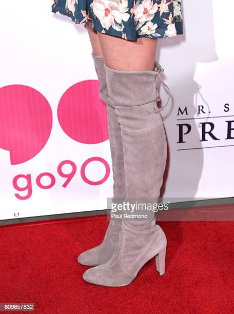 Actress Meghan Reinks boot detail on the red carpet at the Premiere of Verizon go90's 'Mr Student Body President' at TCL Chinese 6 Theatres on...