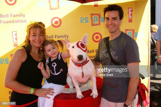 Actress Megyn Price and her family attend the PS ARTS ''Express Yourself 2009'' at Barker Hangar on November 15 2009 in Santa Monica California